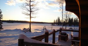 Winter photo from the front of a cabin at Loon Bay Resort on Sheridan Lake